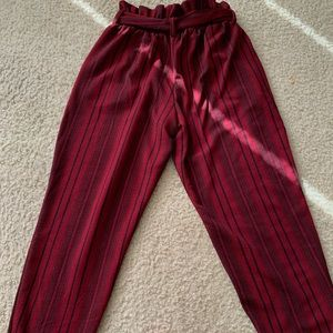 Red and black striped dress pants.